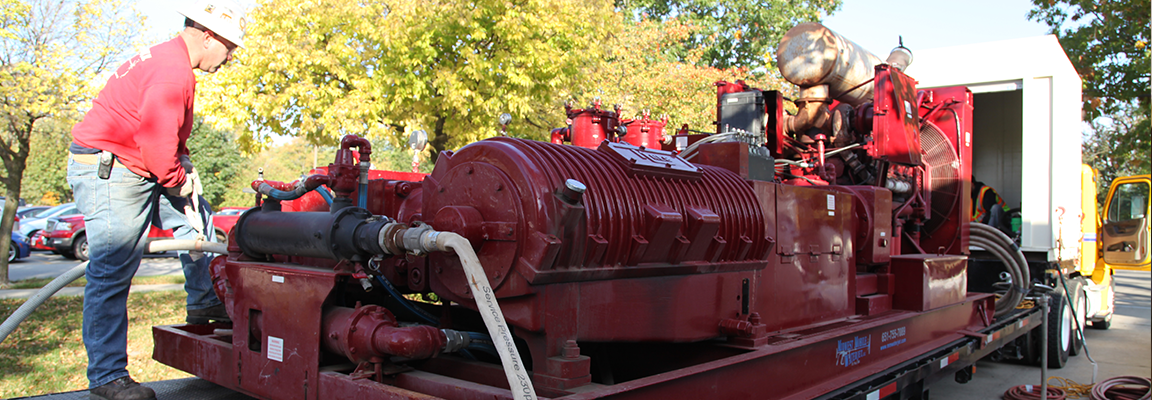 large red machine with engineer working