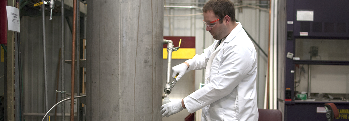 Chris Koza conducts fungal airlift bioreactor research