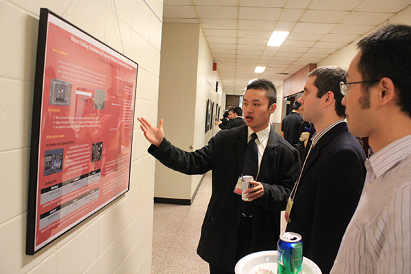 Xin Wang, a master's student in geotechnical/materials engineering, presents at the 4th Annual CCEE Graduate Research Showcase and Poster Competition, held Dec. 2 at the Town Engineering Building.