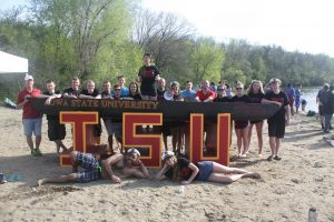 ISU ASCE Concrete Canoe team poses with concrete canoe