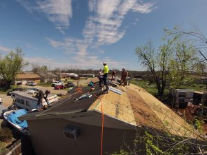 AGC members work on a roofing project