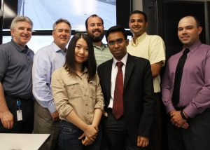 Huang (front left), Chakraborty (front right), Sharma (second from right in back) and Barrette (back right) stand with REACTOR Lab Team at InTrans