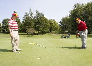 Cleasby (left) and Sanders watch for the outcome of a putt (Photo by Kate Tindall)