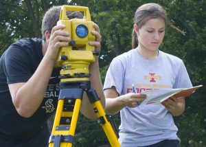Students Robert Thomm (left) and Ashley Price work in teams during a civil engineering (CE) 111: Fundamentals of Surveying I course (Photo by Kate Tindall)