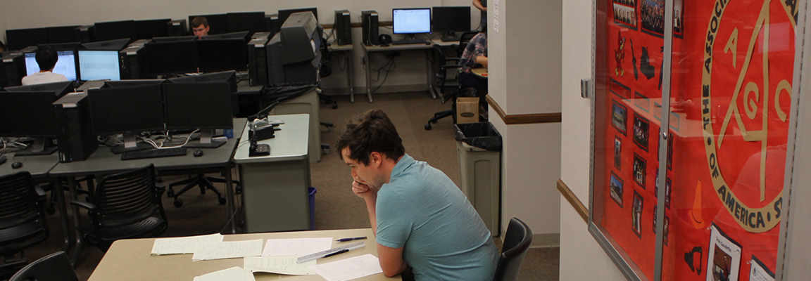Student does homework in Kiewit Student Study Center
