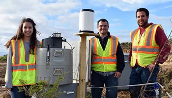 Schussler, co-principal investigator/ISU CCEE Assistant Professor Bora Cetin and Perez at a research site in Tama County, Iowa.